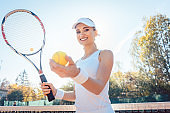 Beautiful woman getting ready to play tennis