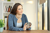 Relaxed woman contemplating at home
