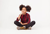 Cute teenage girl in casual stylish clothes sitting