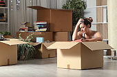 Sad evicted tenant moving home boxing belongings