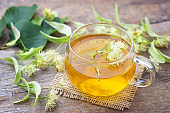 Cup of fresh herbal tea with linden blossom