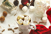 Mug filled with hot chocolate and marshmallows