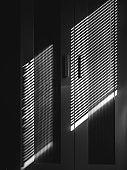 Wardrobe with windows blind artistic shadow