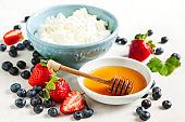Fresh cottage cheese, honey and berries for healthy eating