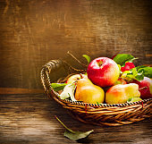 Fresh apples and pears on wooden table. Autumn Harvest