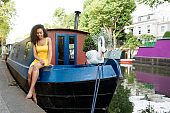 Woman sitting in a houseboat moored in a river