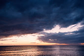 spectacular sunset on a beach with stormy sky