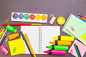 Back to school concept. School education supplies on black stone concrete background