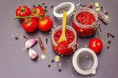 Tomato jam, jam, chutney, sauce in glass jar. Homemade preservation concept