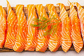 Slices of fresh salmon fish. Raw ingredient for cooking healthy seafood
