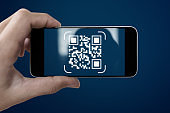 QR code scanning payment and verification. Hand using mobile smart phone scan QR code