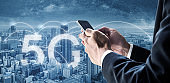 Internet networking, 5G internet and wireless technology. Businessman using mobile smart phone in the city, and 5G internet networking