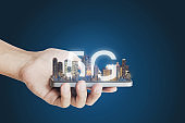 5G internet network technology, Hand holding mobile smart phone and buildings hologram with 5G internet network