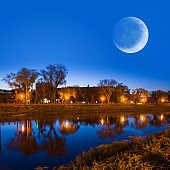 night town scene river and moon