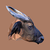 Wild cow low poly design. Triangle vector illustration.