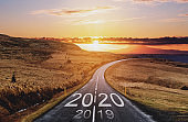 2020 and 2019 on the empty road at sunset. New Year concepts
