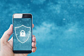 Mobile phone safety and internet online security system. Hand using mobile smart phone with lock icon on screen
