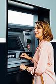 Senior Woman Factory ATM
