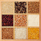 Groats in square wooden box, collection of cereals, beans and seeds, top view