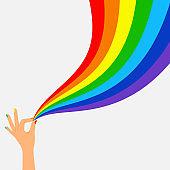 Hand hold wave rainbow flag lgbt banner