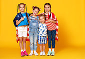 group of children with flag of   United States of America USA on yellow   background