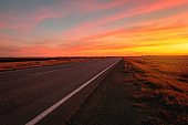 sunset road on a background of colorful sky