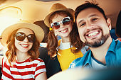 happy   family  in summer auto journey travel by car on beach