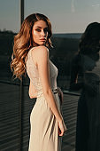beautiful sensual woman with blond hair in elegant clothes