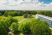 Nice aerial view to meadow, trees and building, Czech landscape