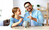 financial planning happy family couple with piggy Bank at home