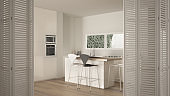 White folding door opening on modern white kitchen with island, stools, ribbon window and parquet floor, white interior design, architect designer concept, blur background