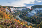 Gorges covered in fall foliage at sunrise creates a majestic scene at Letchworth State Park, NY