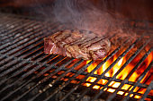 BBQ beef, charcoal grill. Roast and smoke meat for picnic