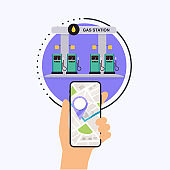 Hand holding mobile smart phone with application search gas station. Find closest on city map. Flat design style modern vector illustration concept.