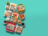 Assortment of trays and plate of sushi and maki