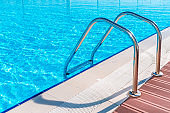 Swimming pool in curved shape with stairs