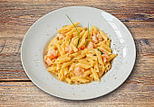 White plate with penne and shrimp