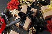 Set of gift box, christmas red balls and black stars on dark background, stylush luxury happy new year concept, xmas holiday present, sale, coupon idea, greering card