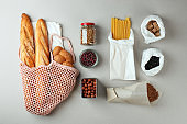 zero waste food shopping. eco natural bags and glass jar with food, eco friendly, flat lay. sustainable lifestyle concept. plastic free items. reuse, reduce, recycle, refuse. groceries in eco bags