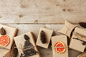 Set of gift box in craft paper with natural decoration on vintage wooden background, Gift holiday concept. Zero Waste lifestyle, border, copy space