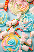Multicolored background made of various colorful candies. Space for text, party, candy bar, childhood, birthday concept