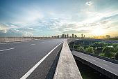 empty asphalt road with modern office building