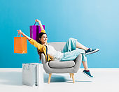 Cheerful shopaholic woman with shopping bags