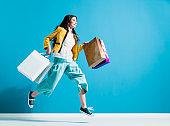 Cheerful happy woman enjoying shopping