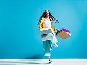 Cheerful young woman enjoying shopping