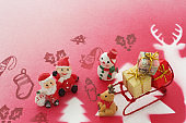 Santa and presents on the background of red and green stenciled hair
