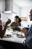 Women friends enjoying a lunch together at home