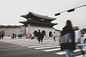Tourists and commuters visiting Gyeongbok palace in Seoul City, South Korea