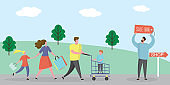 Happy Family shopping.Male with shopping cart and wife with shopping bags,