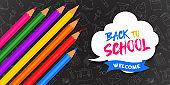 Back to school banner color pencils on blackboard